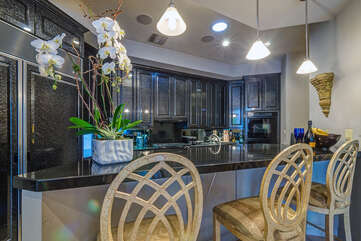 Beautiful Granite Counter Tops and Elegant Lighting