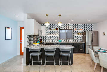 Stainless Steel Bar Seating and Granite Counter Tops