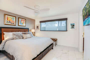 Marble Tile Floors and Plush Bedding