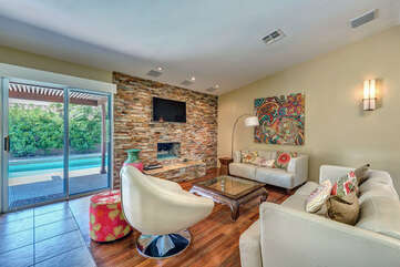 Comfortably Furnished Living Room with Fireplace