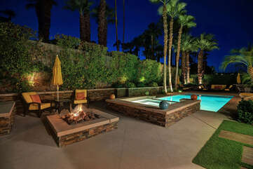 One of Two Fire Pits and Spa at Night