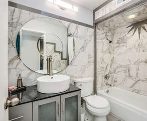 Full Granite Guest Bathroom with Tub and Shower
