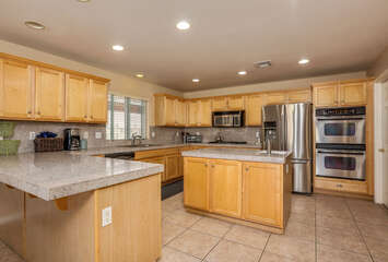Stainless Appliances and Prep Island