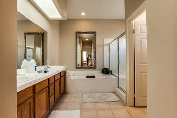 Bright Master Bathroom with Shower and Soaking Tub