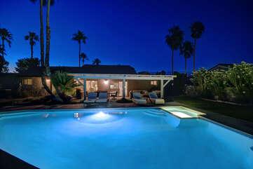 Pool and Spa Looking at House at Night
