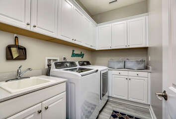 Large Laundry Room with Sink and Washer/Dryer