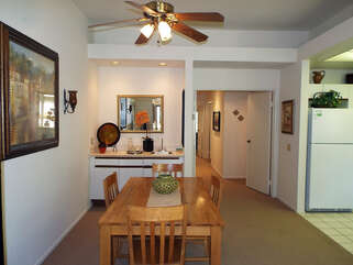 View of Dining Table to Wet Bar and Hallway