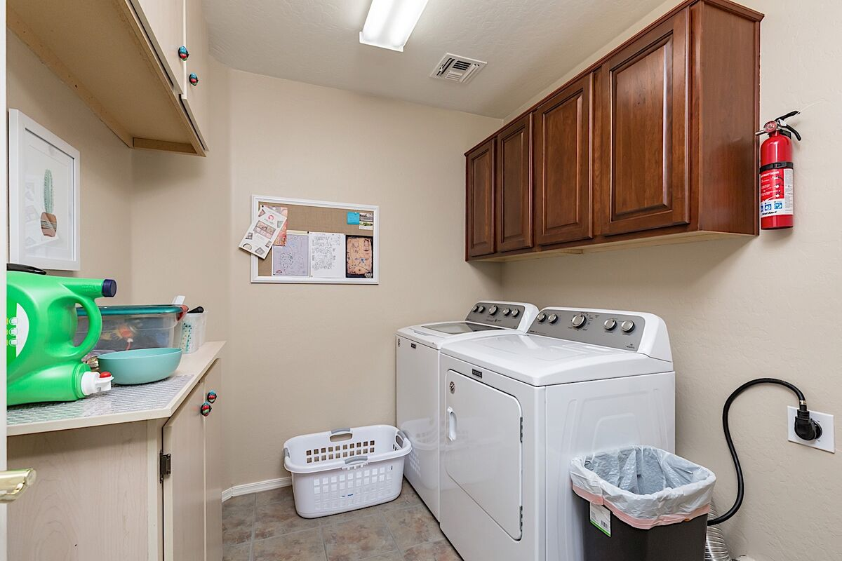 Full size washer and dryer in utility room
