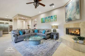 Large cozy couch and gas fireplace