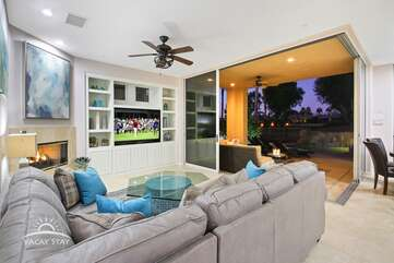 This angle shows how the accordian doors can open up the living room to the backyard and golf course on a nice night