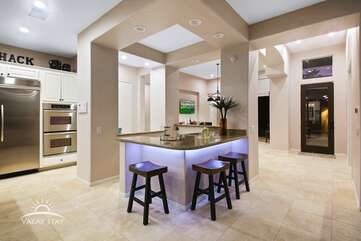 The indoor bar is in the center of the home with easy access to the pool table room, kitchen and family room.