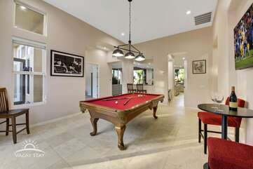 The real slate pool table is in an enormous party room with bar and large HDTV