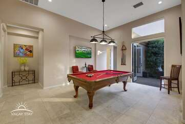 The pool table party room opens right out to the front courtyard sitting area & putting green