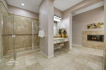 Huge walk in shower and vanity.