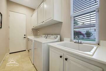 Newer washer/dryer. Go home with clean clothes.  We provide the detergent :)