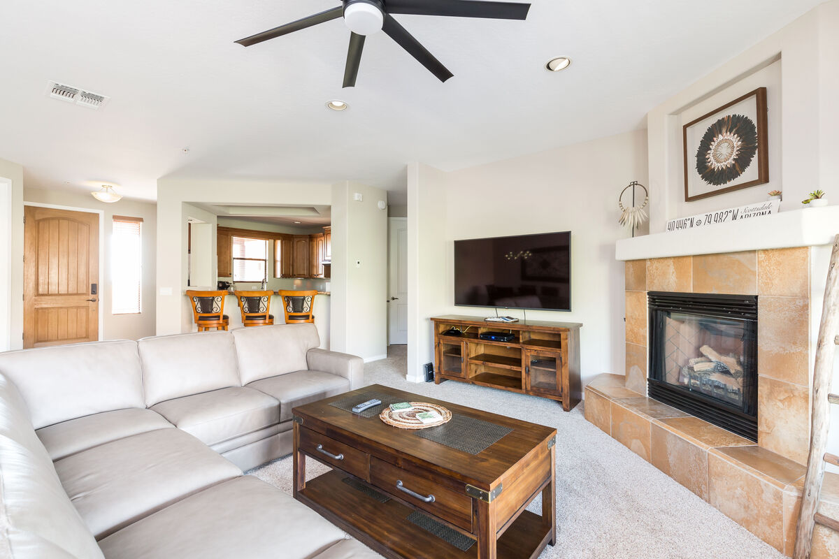 Large sectional sofa to kick back in front of the TV and gas lit fireplace