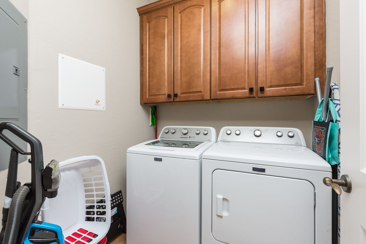 In-house laundry with full size washer and dryer