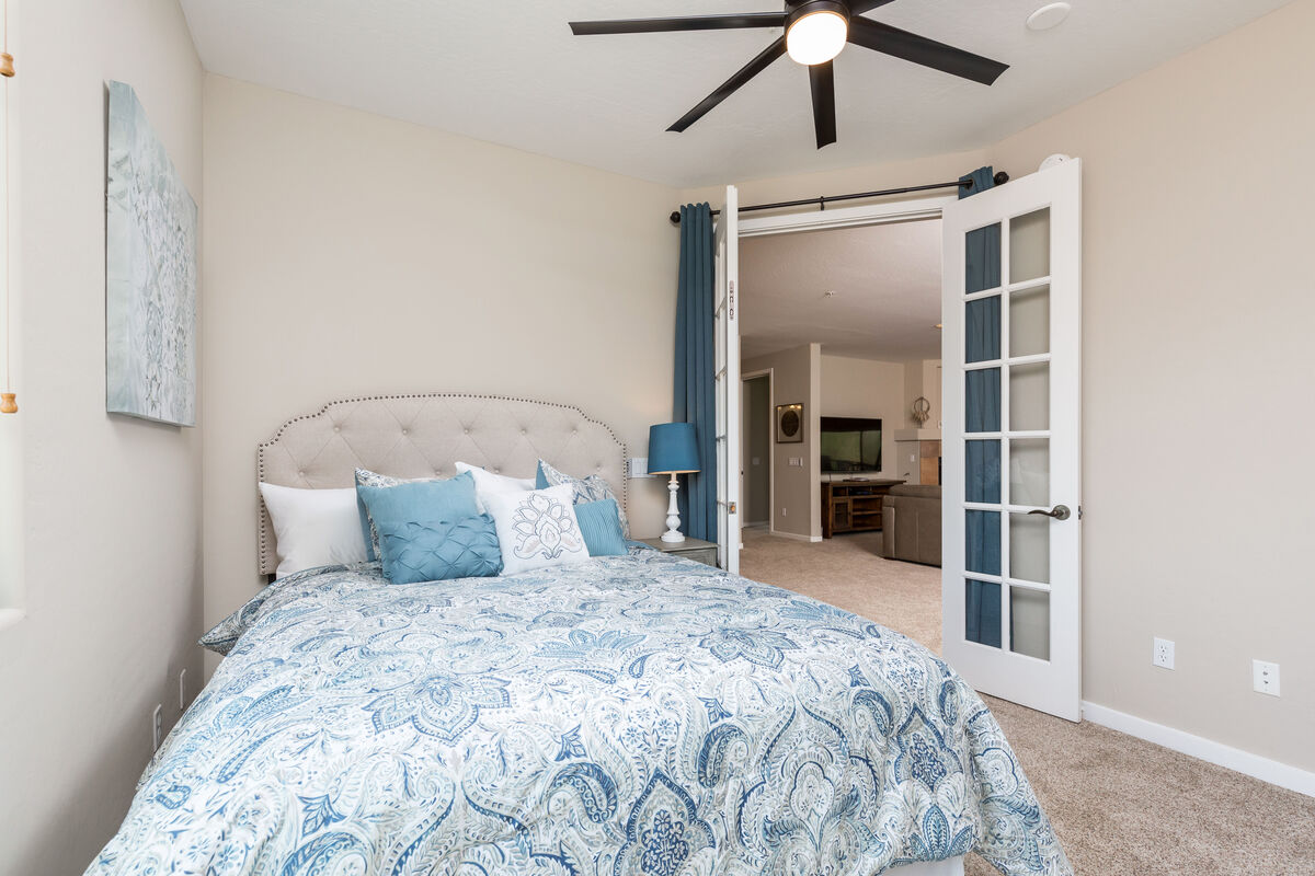 Guest bedroom 2 has privacy curtains to living room