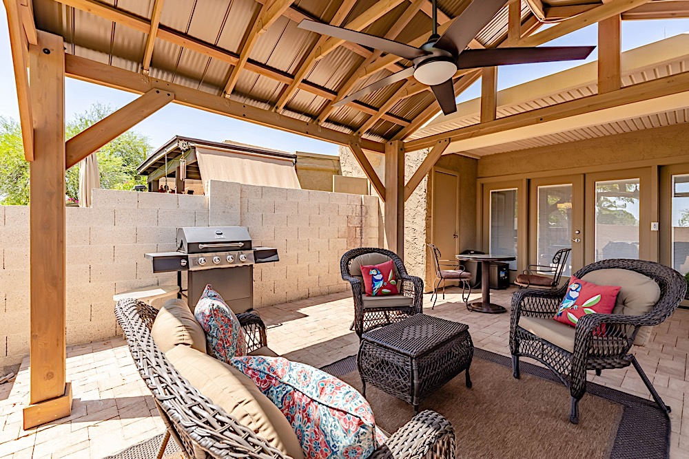 Outdoor sitting area w/ BBQ Grill, high top table, bistro table and 2 chaise loungers