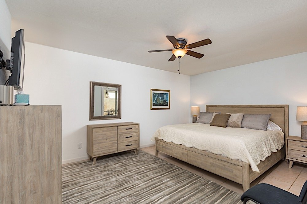 Master bedroom w/ king size bed and flat screen smart TV