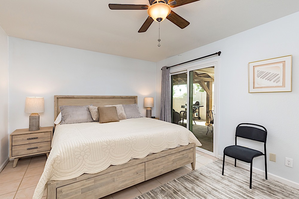 Master bedroom w/ king size bed and private patio entry