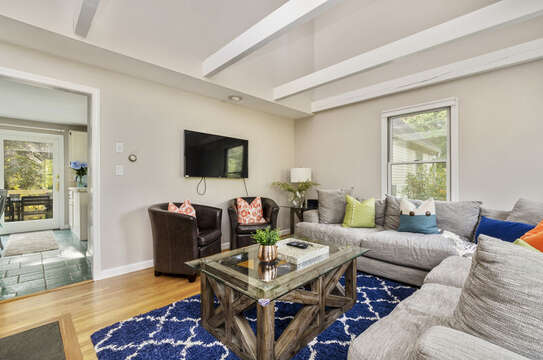 Second living area off kitchen flat screen tv and ample comfy seating. 50 Blue Heron Eastham Cape Cod - New England Vacation Rentals
