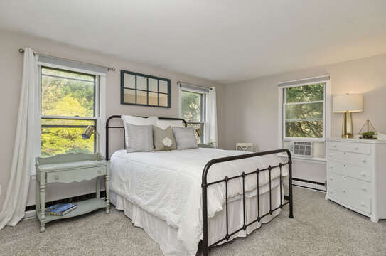 Bed room 1 Queen bedroom with Ac unti, dresser and plenty of natural light 50 Blue Heron Eastham Cape Cod - New England Vacation Rentals