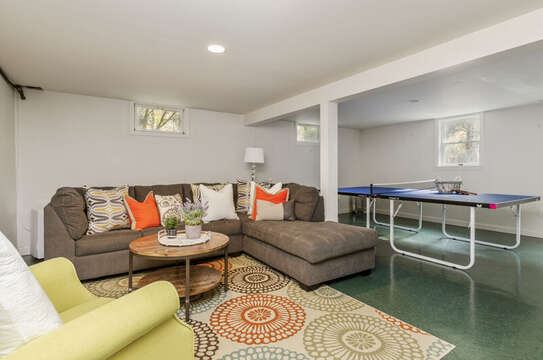 Entertainment room with ping pong table , couch  and comfy chair 50 Blue Heron Eastham Cape Cod - New England Vacation Rentals