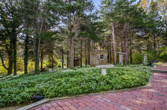 Brick patio with mature plantings 50 Blue Heron Eastham Cape Cod - New England Vacation Rentals