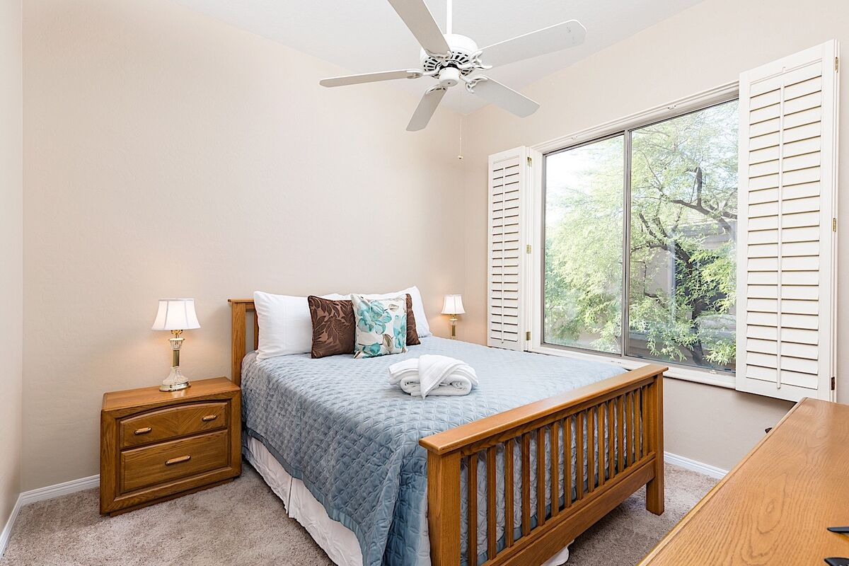 Let in the sunlight in the guest bedroom!