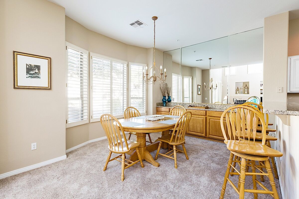 Dining table has room for 6 guests.  There is a leaf in the hall closet near front door
