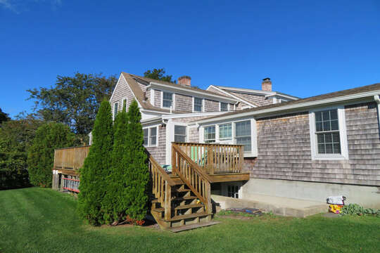 Easy access from the kitchen and living area to the deck offering gates at  both entry and exit for safety of fido or small children! 60 Sisson Road Harwich Port Cape Cod New England Vacation Rentals