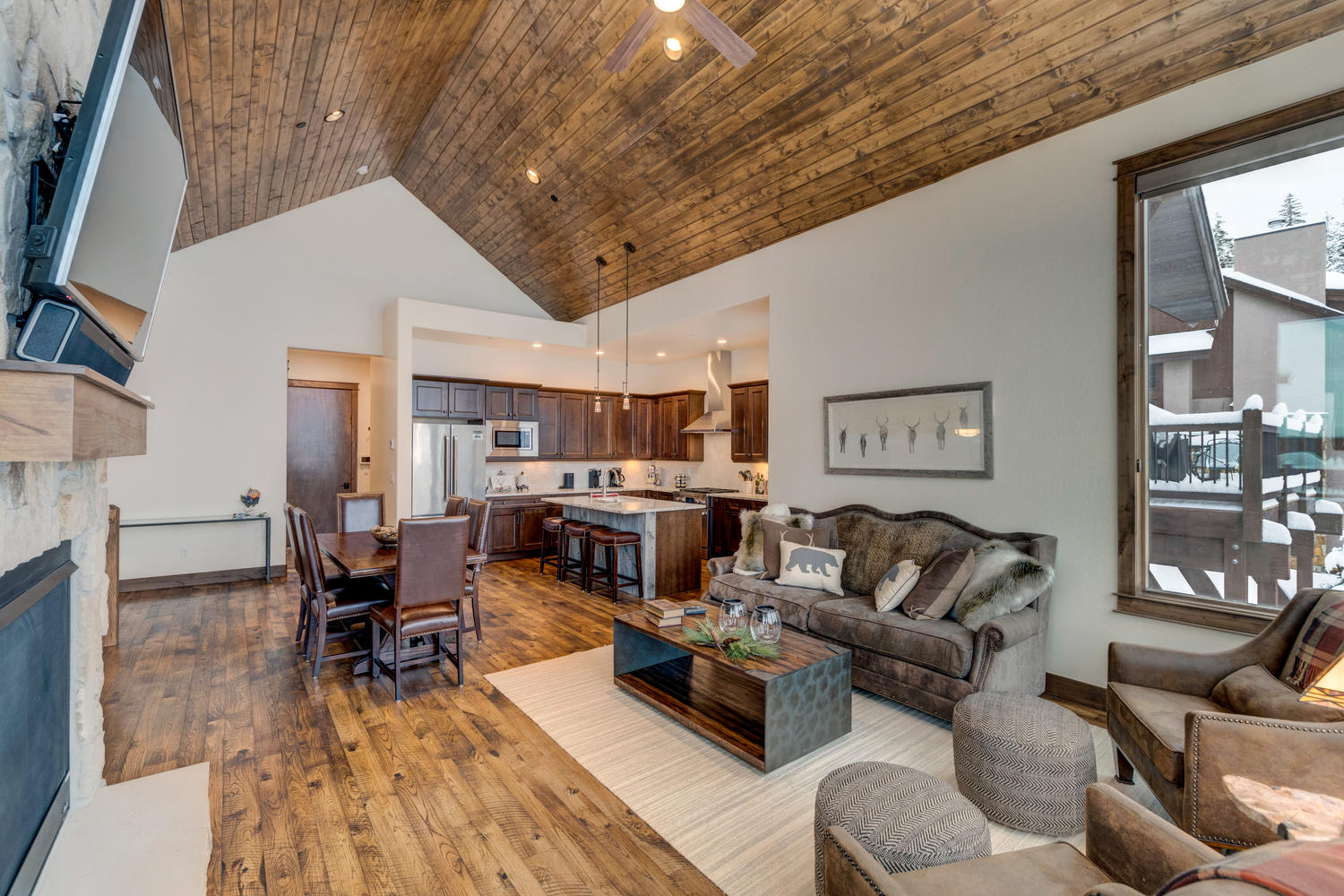 Large vaulted ceiling area with custom wood trim