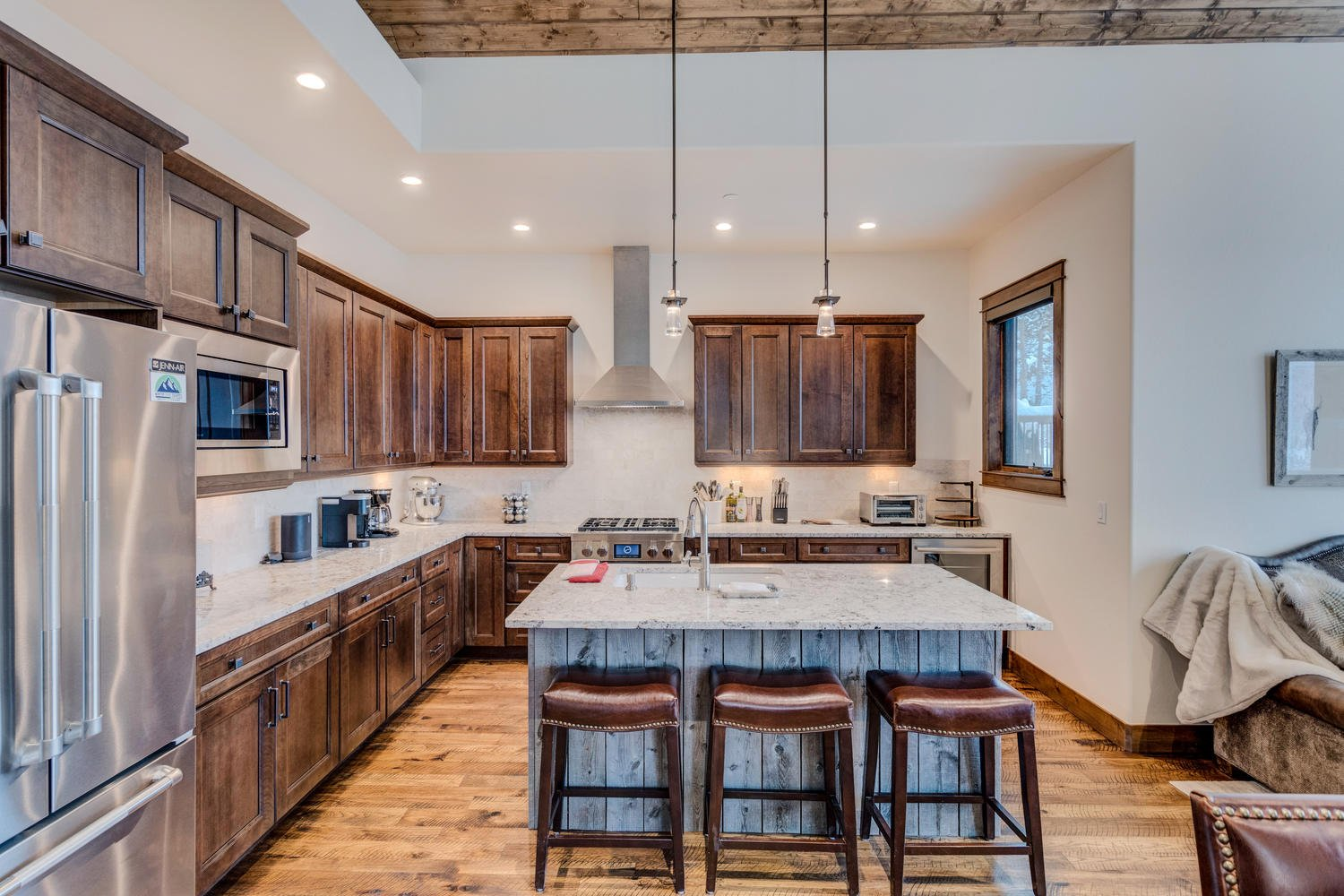 Fully equipped kitchen with large island area.