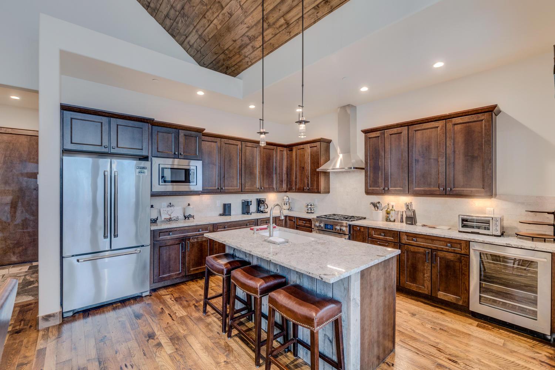 Large chef's kitchen with additional wine fridge