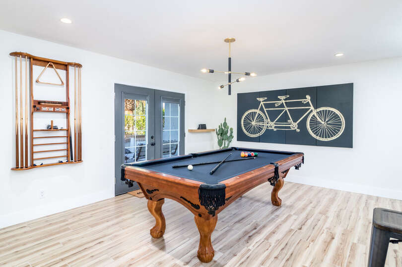 Walking into the home you will find a area with a Pool Table and Bar seating.