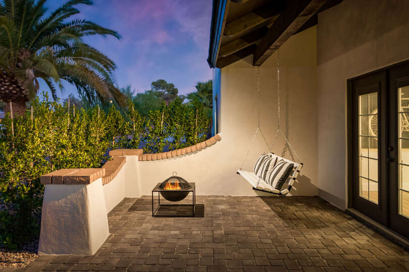 The front patio has a gorgeous Swing Set with a fireplace to accompany you.