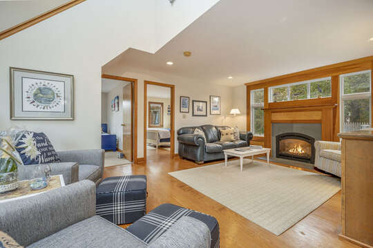 Open family room with gas fireplace and 2 comfy chairs. 350 Barn Hill Road Chatham Cape Cod - New England Vacation Rentals