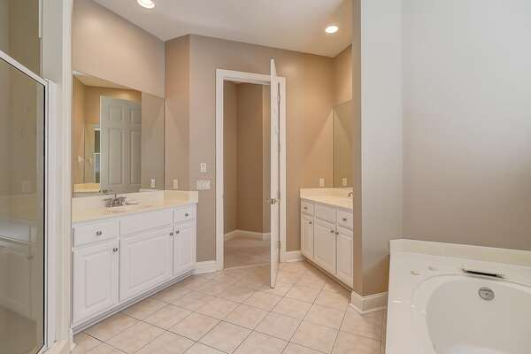 First floor master bathroom with soaking tub, dual vanities and walk in shower