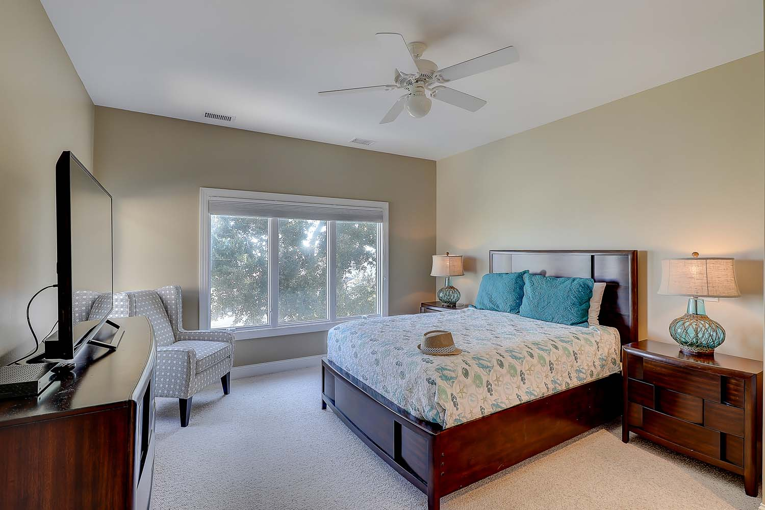 Upstairs ocean view queen bedroom with access to hall bathroom that has dual vanities and standup shower