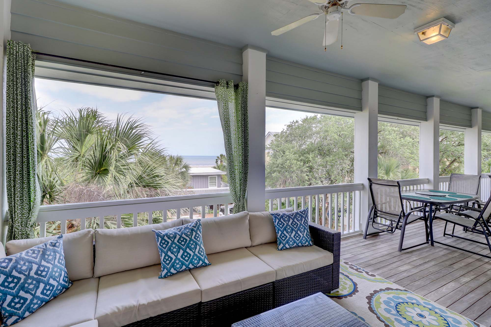 Outdoor living is beautiful on Hilton Head Island and at Dune Lane 28, this is no exception. Large sectional, TV, dining table, Chaise loungers and grill make for a great way to relax and stare at the ocean
