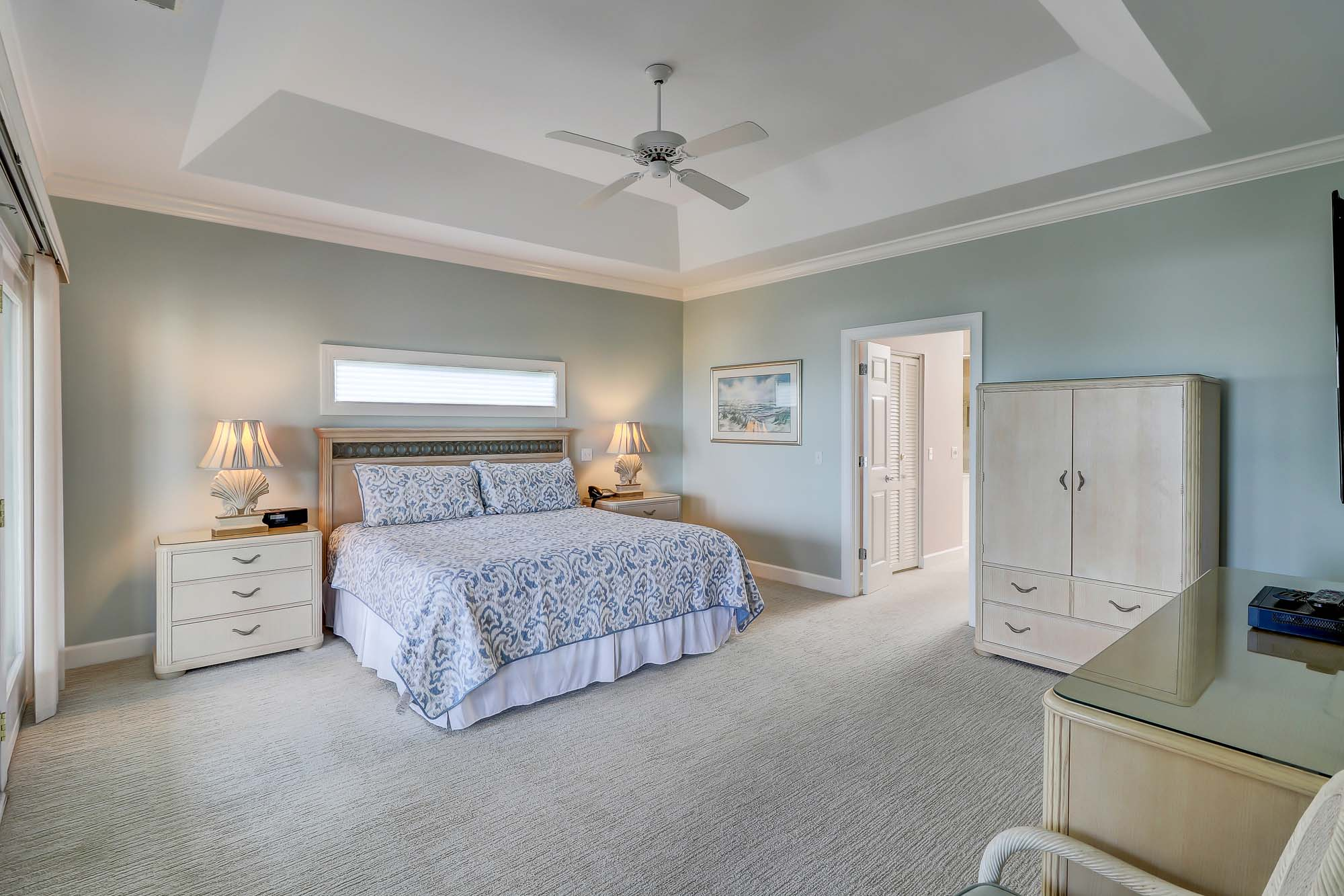 Upstairs master bedroom is large and features king bed, large wall-mounted flat panel TV, access to ocean view covered balcony and has a private en suite bath with 2 vanities, soaking tub and glass-enclosed walk-in shower with accupressure stone floors