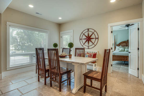 The dining table comfortably seats 6 but can accommodate 8