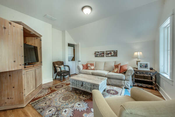 Upstairs living room has flat panel TV, sitting area and the home's second laundry center, which is a stackable washer and dryer for convenience to the 2nd floor occupants
