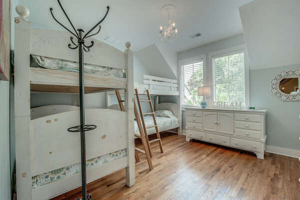 Bedroom 4 has two sets of twin bunk beds, allowing for sleeping capacity of 4 total to this room. The room is located on 2nd floor, faces the rear of the home and has access to the hall bath shared by bedroom 4 and 5.