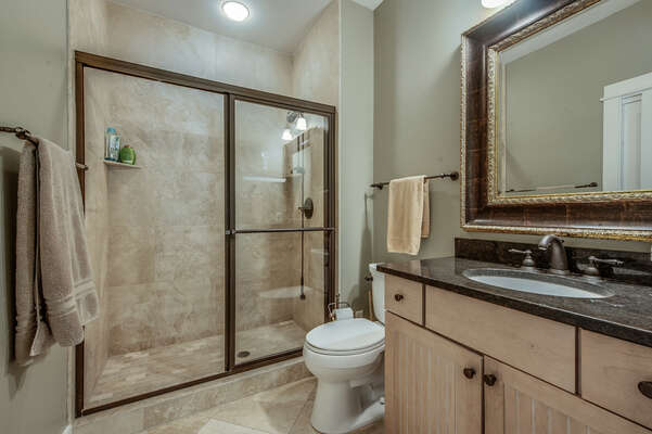 Hall bath for bedroom 4 and 5 has glass-enclosed walk in shower