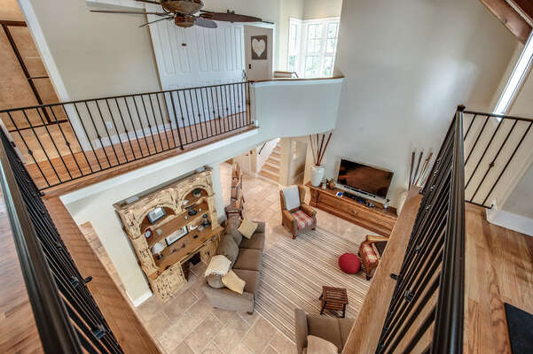 View down to main living room from upper level hallway
