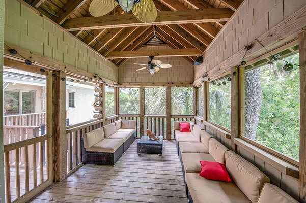 Screened porch is a great hideaway for inclimate days or to escape the sun, outdoors. ceiling fans, convertable seating and cocktail table make this a great space to unwind
