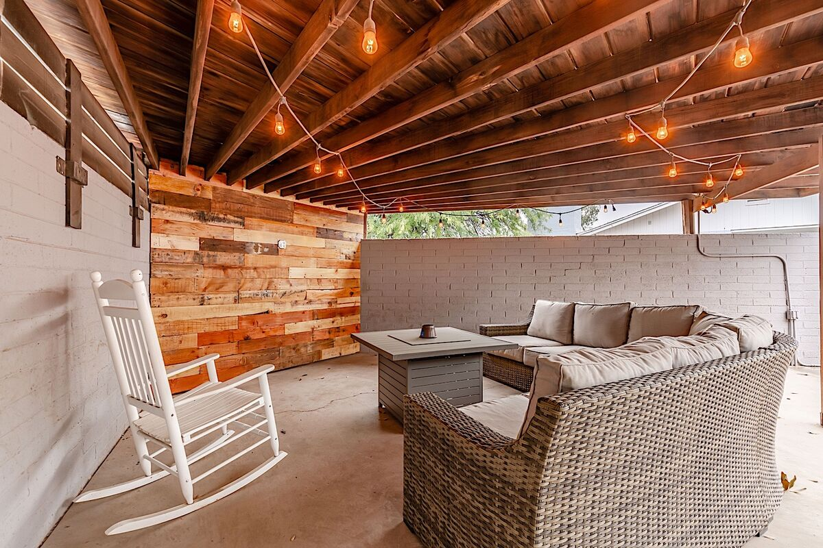 Awesome covered patio with sectional seating and fire pit.