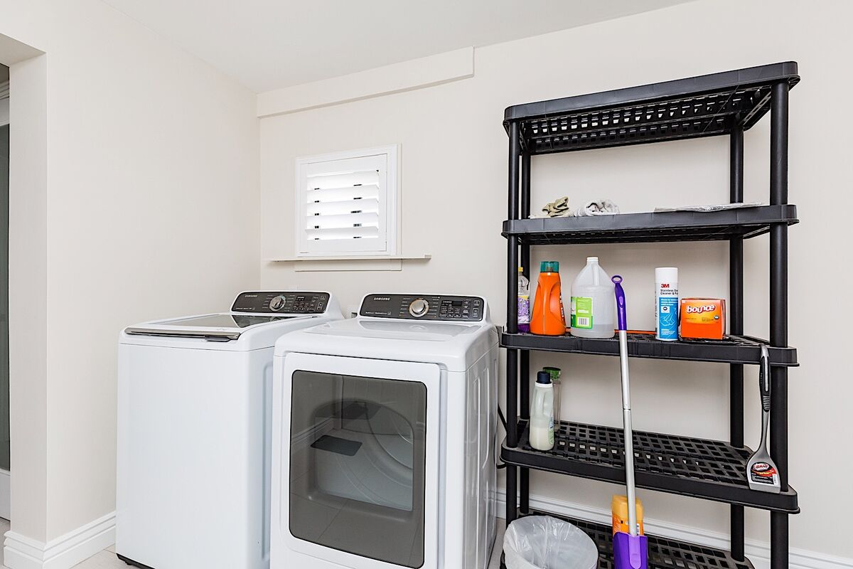 Full size washer and dryer in utility room. Plenty of storage for guests traveling with road bikes to explore the outdoors!